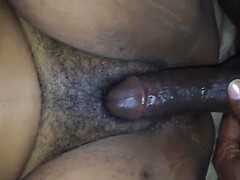 Rubbing black dick all over her super wet pussy and pushing it deep inside